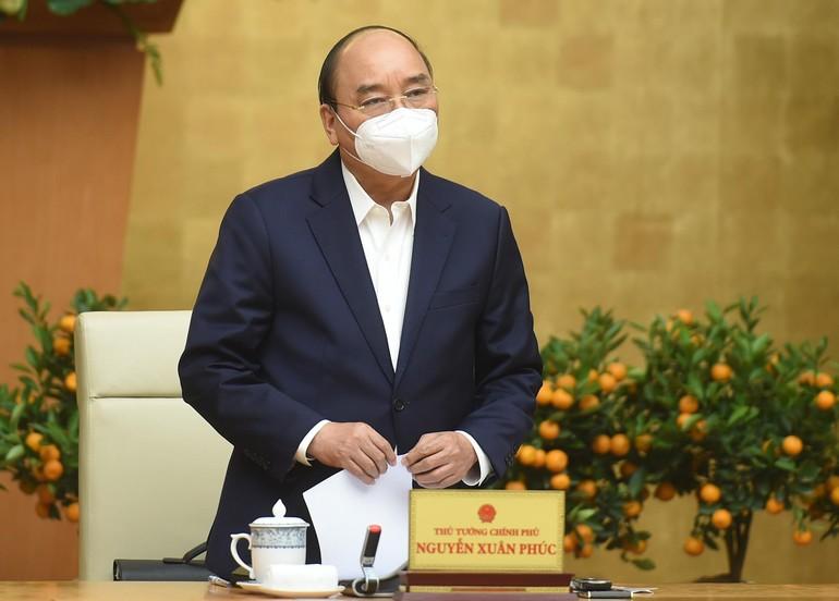 Thủ tướng Nguyễn Xuân Phúc chủ trì cuộc họp Thường trực Chính phủ về phòng chống Covid-19 - Ảnh: VGP/Quang Hiếu