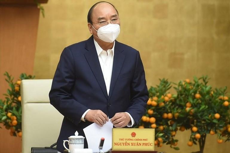 Thủ tướng Nguyễn Xuân Phúc chủ trì cuộc họp Thường trực Chính phủ về phòng chống Covid-19. Ảnh: VGP/Quang Hiếu